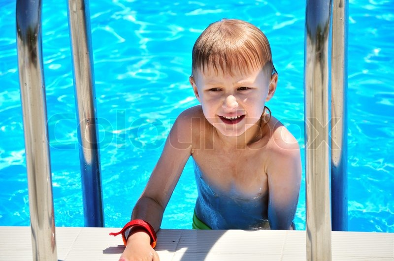 Stock image of 'funny little boy coming out swimming pool'