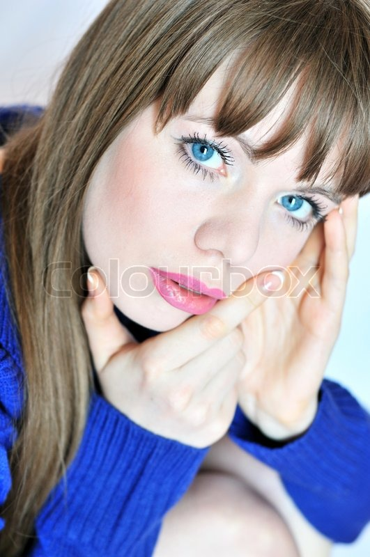 Stock image of 'Thoughtful blue-eyed girl'