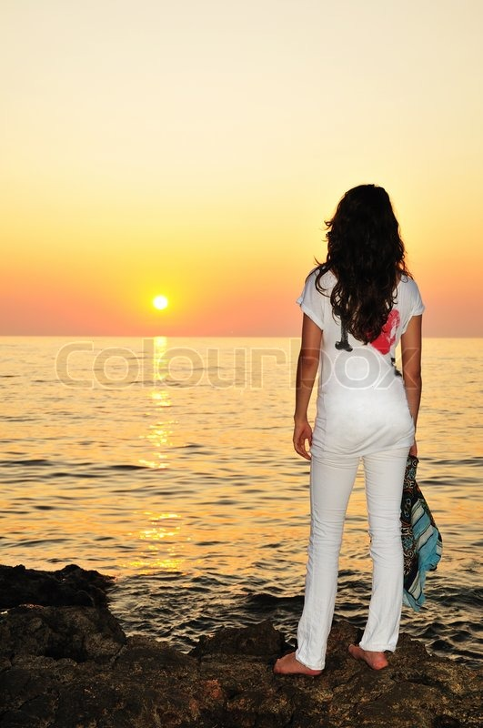 Stock image of 'Girl at sunset time'