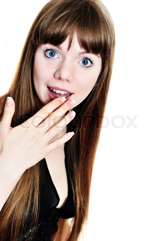 Stock image of 'surprised girl with long hair and hand near her face '