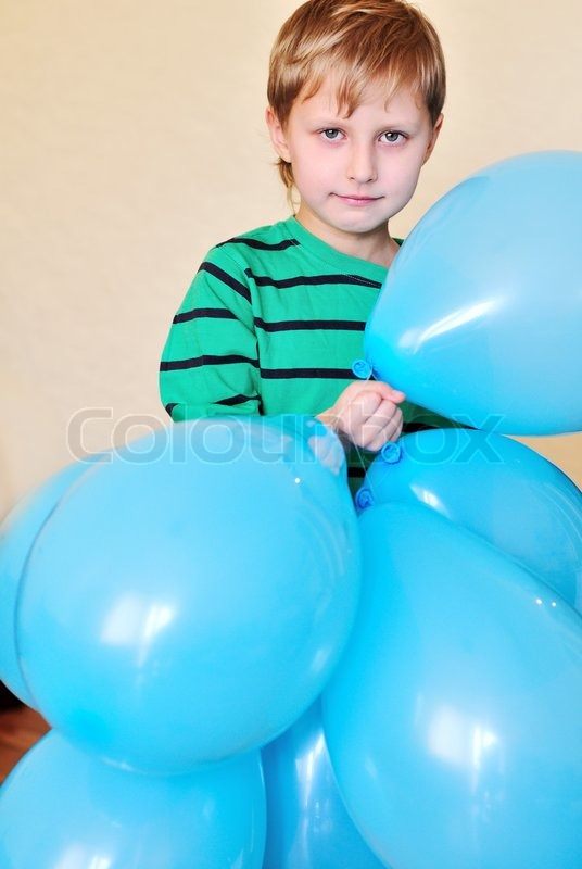 Stock image of 'Boy holding a lot of balloons'
