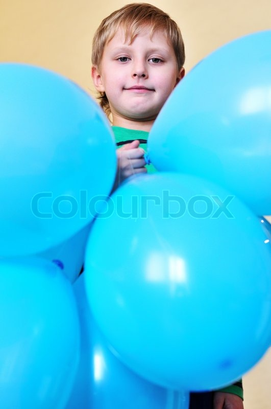 Stock image of 'Boy holding balloons'