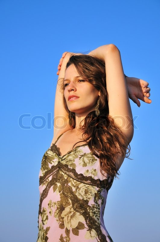 Stock image of 'Girl over blue sky'