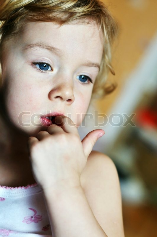 Stock image of 'nail-biting - bad habit for children in soft focus '