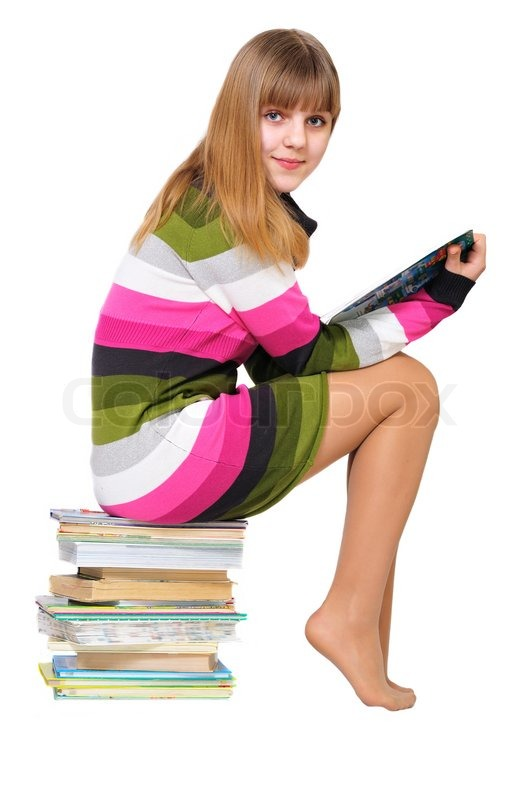 Stock image of 'Sweet teen on the pile of books'