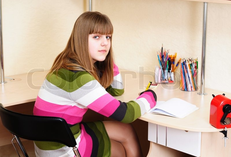 Stock image of 'Teen girl doing homework'