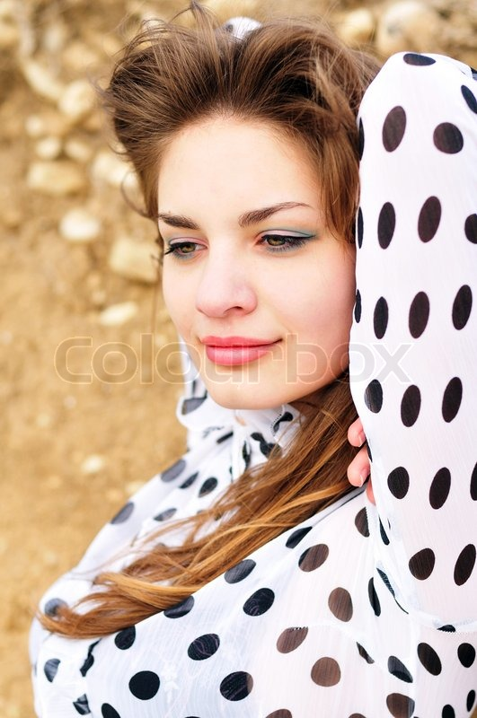 Stock image of 'Young girl wearing spotted blouse'