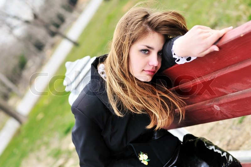 Stock image of 'Sad girl in the park'