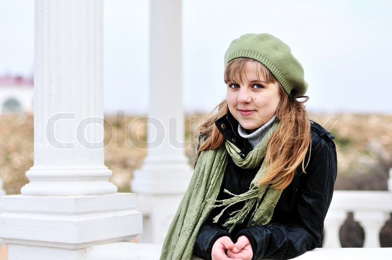 Stock image of 'Teen girl standing near the columns'