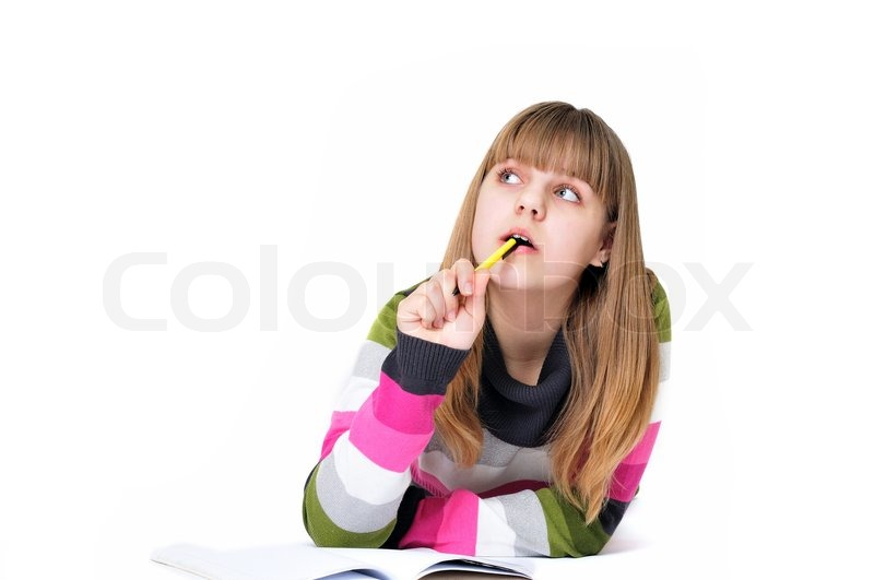 Stock image of 'Writing dreaming laying teen girl'
