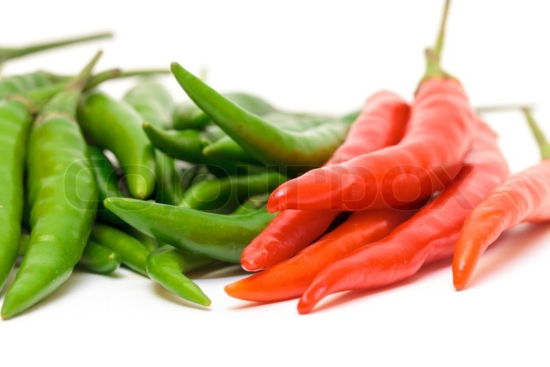 Stock image of 'Heap Red and Green Chilli Hot Peppers'