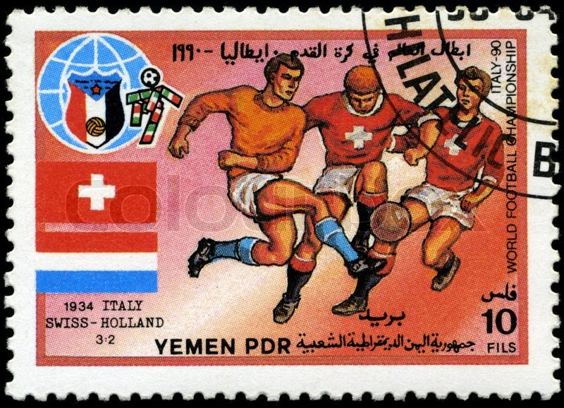 Editorial image of 'YEMEN - CIRCA 1990: stamp printed by Yemen, shows soccer players and ball, circa 1990'