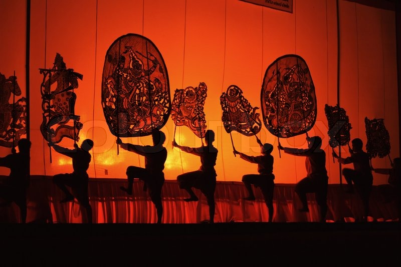 Editorial image of 'RATCHBURI, THAILAND - APRIL 14: Large Shadow Play is performed at Wat Khanon on April 14, 2012 The ancient performing art involves manipulating puppets of cowhide in front of a backlit white screen'