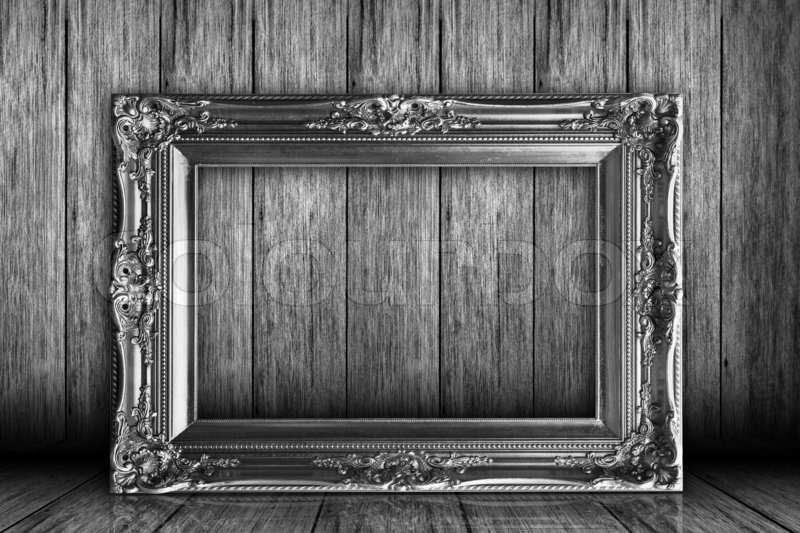 Stock image of 'Old grunge room with picture frames'