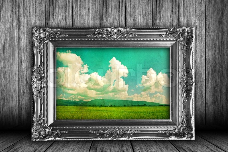 Stock image of 'Old grunge room with frames and old photos pasture'