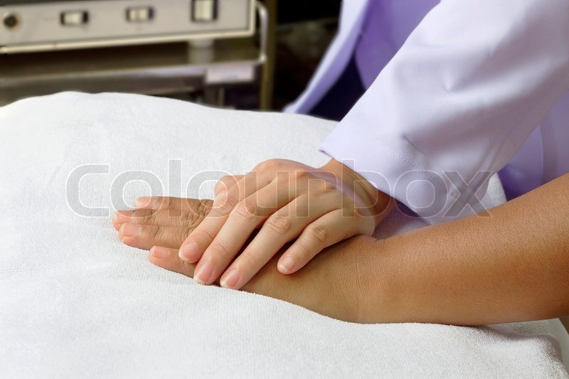 Stock image of 'Doctor'hand helping senior's hand,hold hand together '