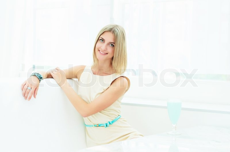 Stock image of 'Portrait of a beautiful woman in the cafe'
