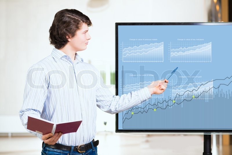 Stock image of 'young business man shows on the monitor financial growth charts, making presentations'
