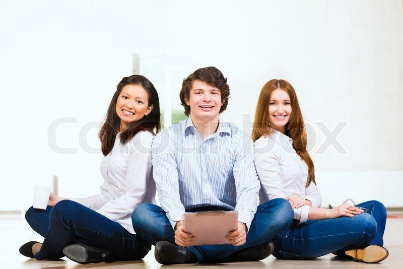 Stock image of 'Portrait of a group of young people'