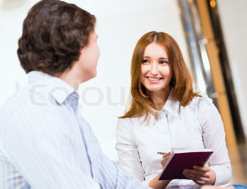 Stock image of 'Attractive woman talking with a man'