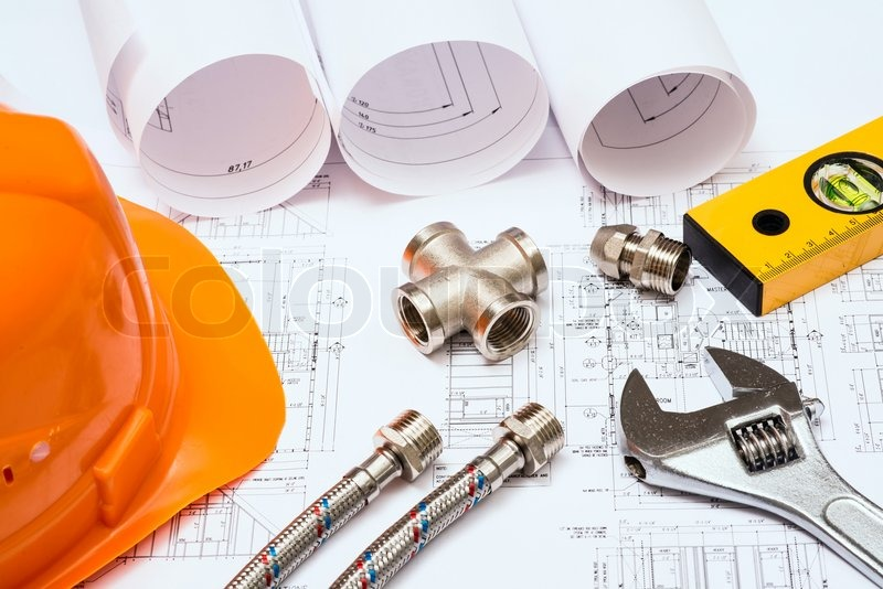 Stock image of 'Plumbing and drawings, construction still life'