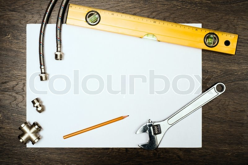 Stock image of 'Plumbing tools on a white sheet of paper'
