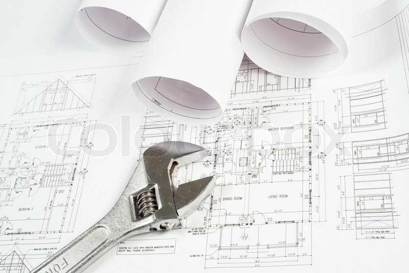 Stock image of 'Wrench and drawings, construction still life'