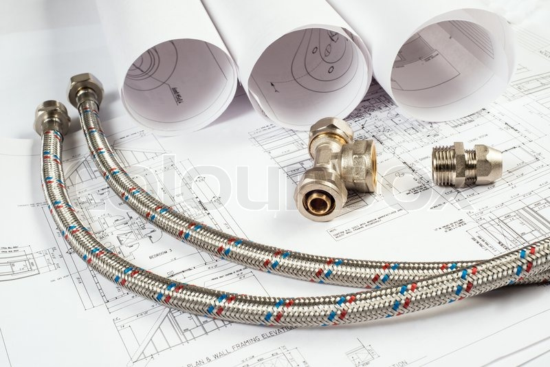 Stock image of 'plumbing and drawings are on the desktop, workspace engineer'