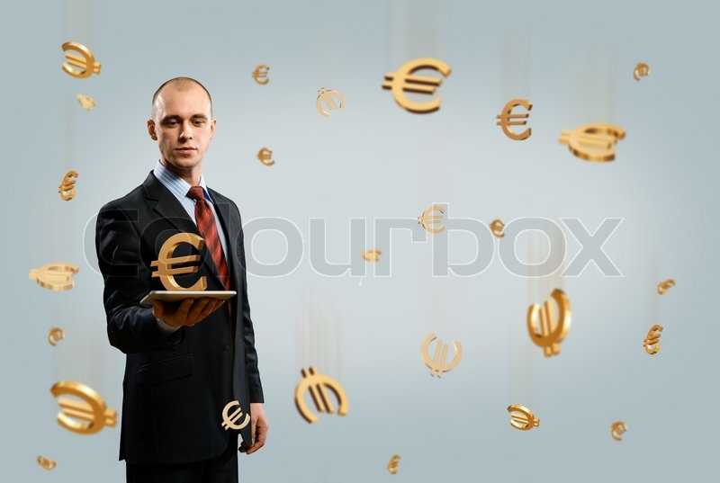 Stock image of 'Man holding tablet with euro symbol'
