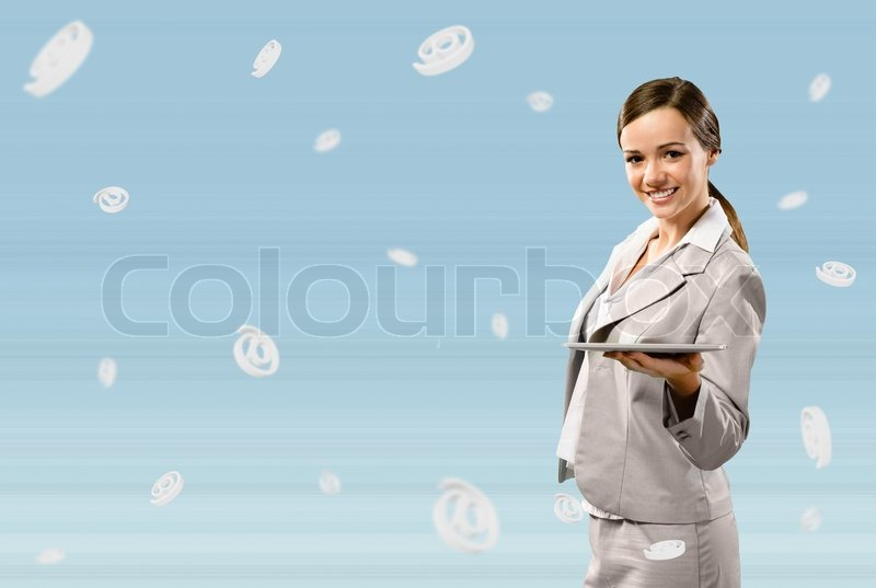 Stock image of 'Attractive business woman holding a table'