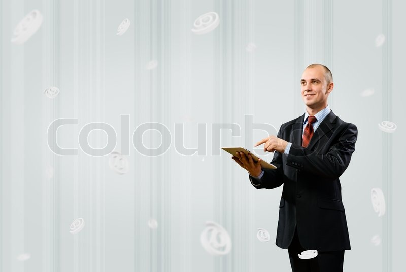 Stock image of 'Business man holding a table'