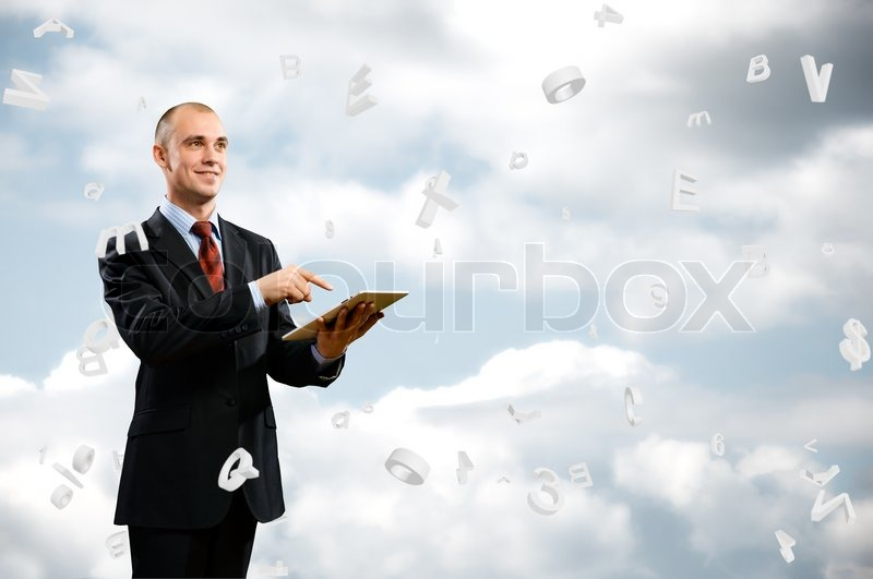 Stock image of 'Business man is working with tablet'