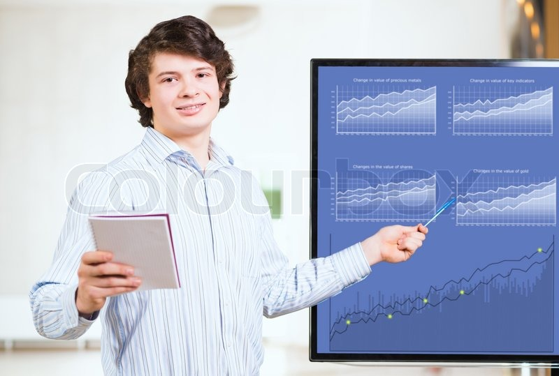 Stock image of 'Young business man shows on the monitor charts'