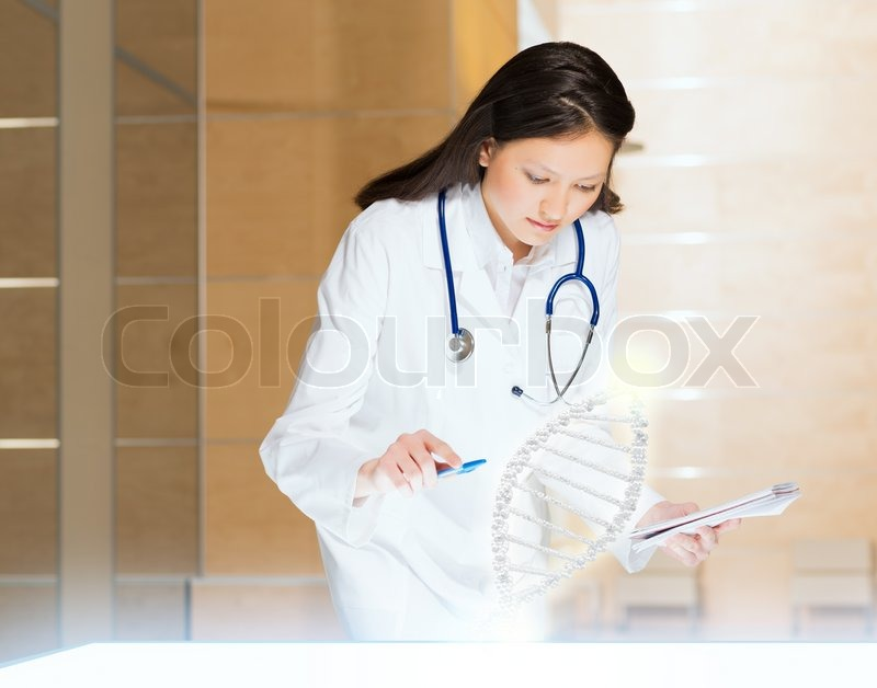 Stock image of 'Young woman doing research'