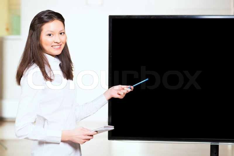 Stock image of 'Asian businesswoman shows blank screen'