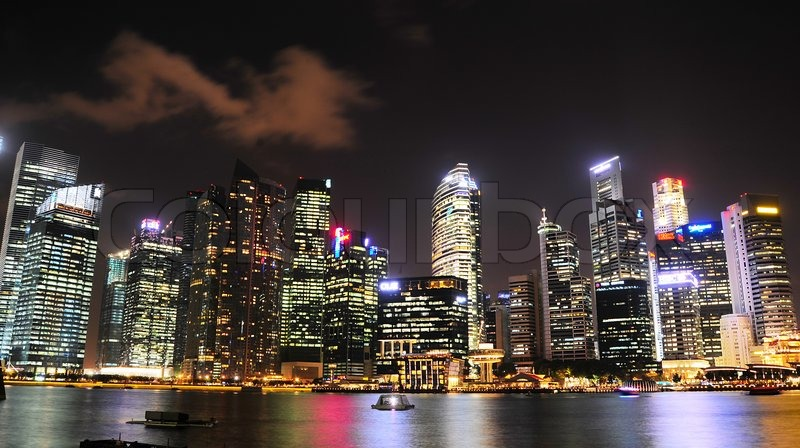 Editorial image of ' Singapore - March 05, 2013:  Night panorama of Singapore downtown. There are more than 7,000 multinational corporations from United States, Japan and Europe in Singapore. '