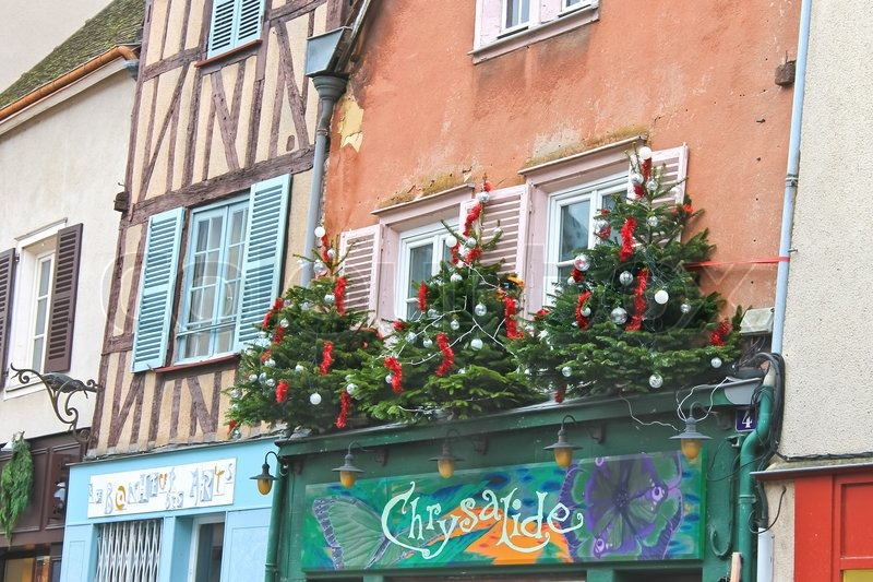 Editorial image of 'Decorative Christmas trees on a house facade in Chartres, France'