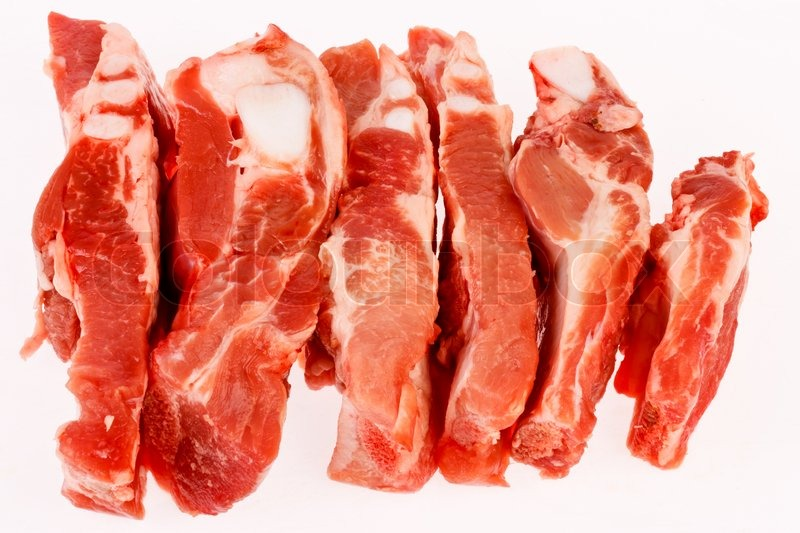 Stock image of 'Raw Pork ribs in isolated on white'