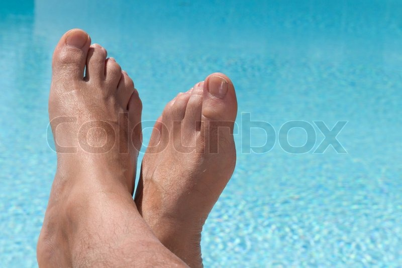 Stock image of 'Relaxing in a swimming pool'