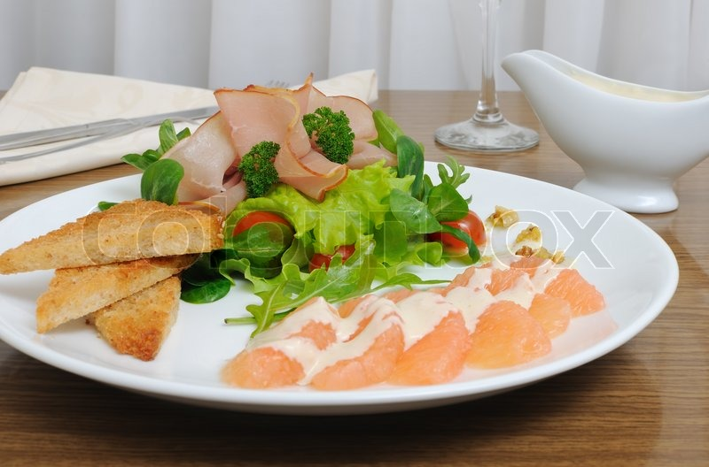Stock image of 'Appetizer of jamon with vegetables'