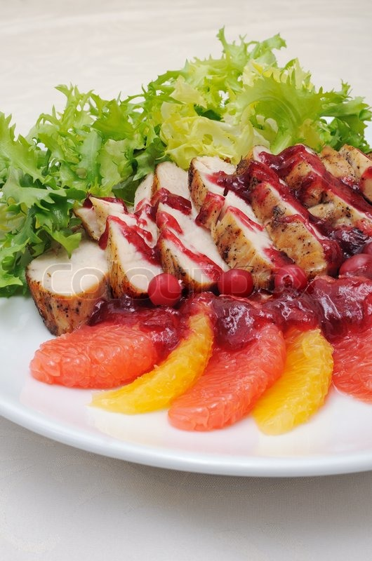 Stock image of 'Sliced ​​baked fillet with cranberry sauce'