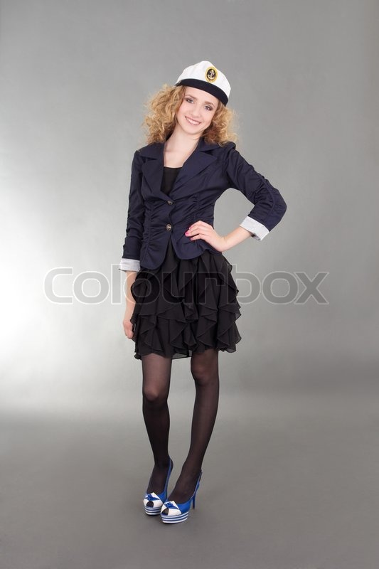 Stock image of 'Young sailor woman over grey background'