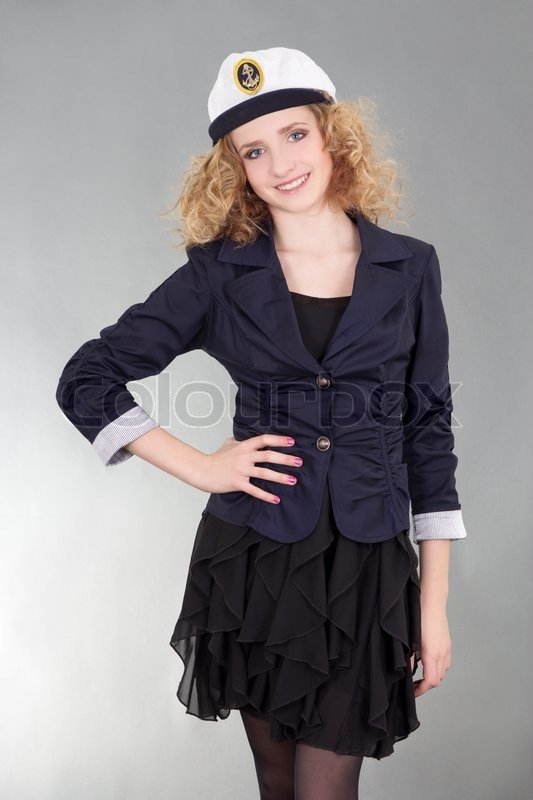 Stock image of 'Young sailor woman over grey'