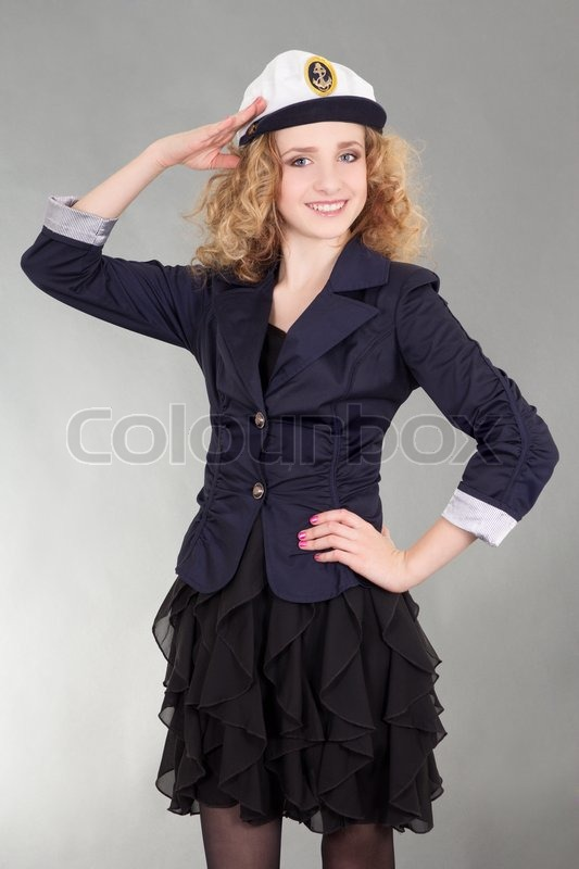 Stock image of 'Young beautiful woman in captain cap'