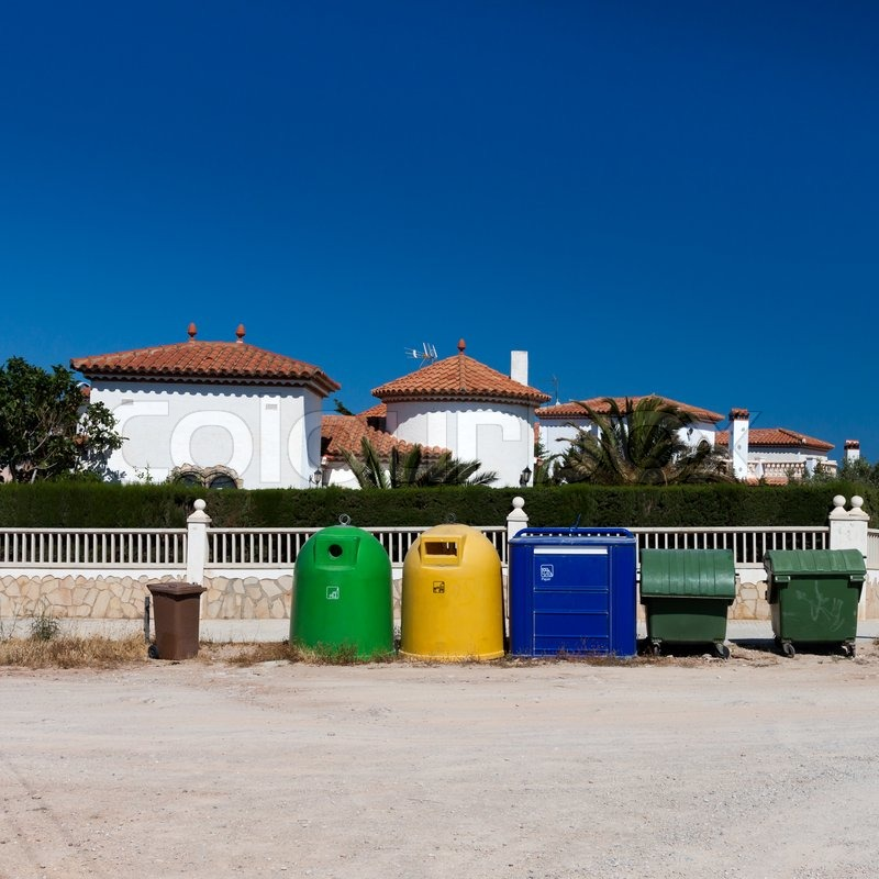 Stock image of 'Colored garbage bins to separate and recycle'