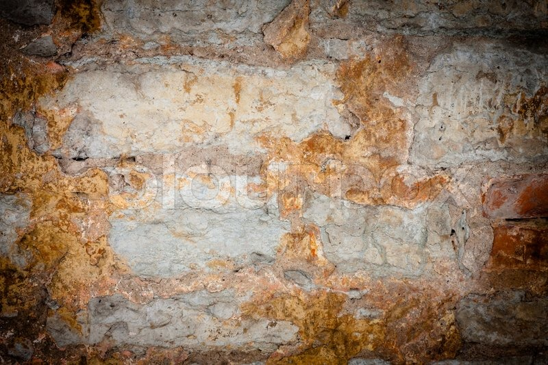 Stock image of 'Rusty stone wall'
