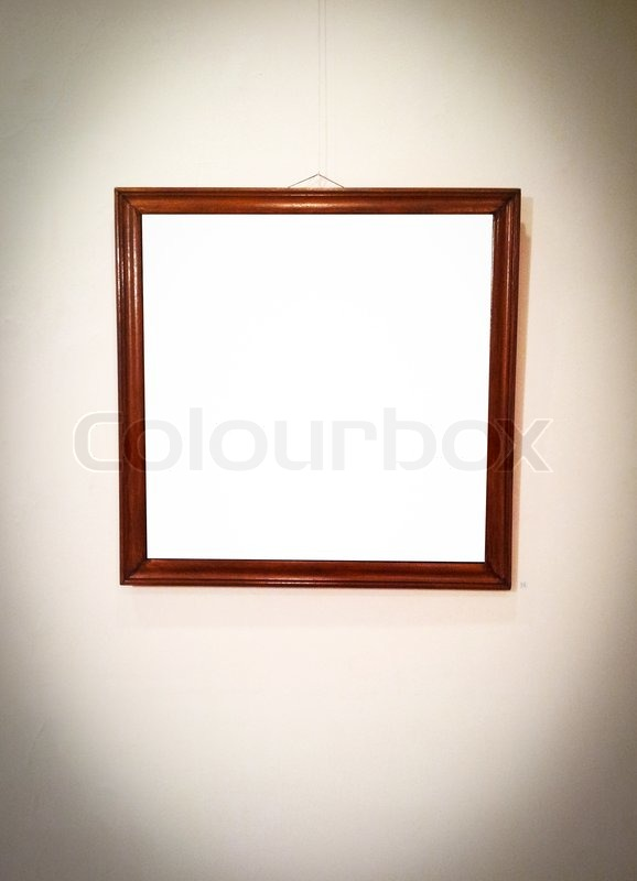 Stock image of 'Empty picture frame on wall'