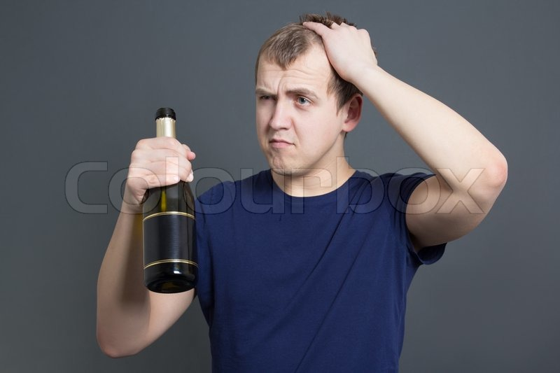 Stock image of 'Drunk man with bottle of champagne'