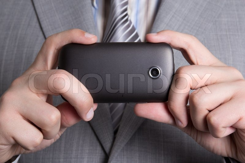 Stock image of 'mobile phone camera in male hands'