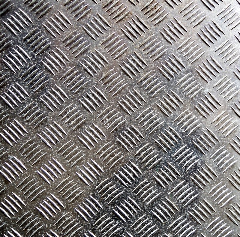 Stock image of 'Old metal ribbed surface'